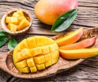 Mango fruit and mango cubes. Stock Image
