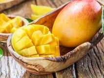 Mango fruit and mango cubes. Royalty Free Stock Photos
