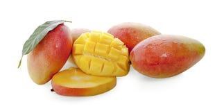 Mango fruit with mango cubes and slices. stock image
