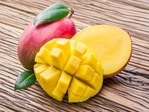 Mango fruit and mango cubes. Royalty Free Stock Photography