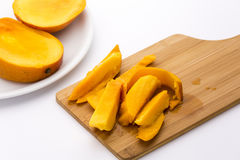 Mango Fruit Pulp And Its Peel On A Cutting Board Royalty Free Stock Images
