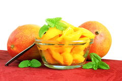 Mango fruit slice or salad  with mint and mango in pure white background Royalty Free Stock Images
