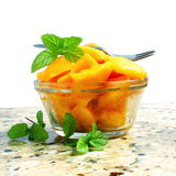 Mango fruit slice or salad  with mint in pure white background Stock Photography