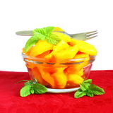 Mango fruit slice or salad  with mint in pure white background Royalty Free Stock Photos