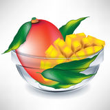 Mango fruit and slices in bowl Stock Photos