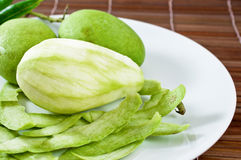 Mango fruit on white dish. Closeup Stock Image