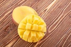 Mango fruit on wood Royalty Free Stock Images