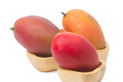 Mango fruit  in the wooden bowl Stock Image