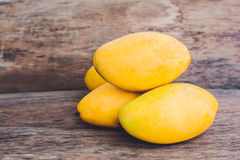 Mango fruit on the wooden table. Royalty Free Stock Photos