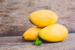 Mango fruit on the wooden table. Stock Photo