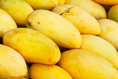 Mango fruits on the local market stand Stock Photos