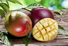 Mango fruits on a wooden table. Royalty Free Stock Photo