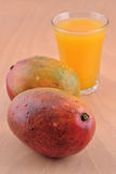 Mango and a glass of juice Royalty Free Stock Images