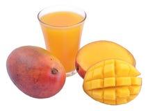 Mango and a glass of mango juice Stock Photos