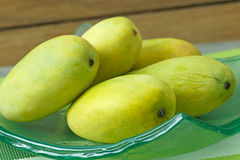 Mango. On a glass plate Royalty Free Stock Image