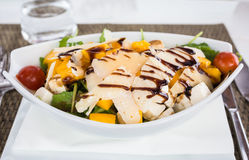 Mango, goats cheese, salad. Royalty Free Stock Photography