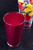 Mango, grapefruit and blueberry smoothie. Fresh fruit salad. Slices of fruits.  Close-up Stock Images