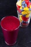 Mango, grapefruit and blueberry smoothie. Fresh fruit salad. Slices of fruits.  Close-up Stock Photos