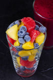 Mango, grapefruit and blueberry smoothie. Fresh fruit salad. Slices of fruits.  Close-up Royalty Free Stock Image