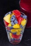 Mango, grapefruit and blueberry smoothie. Fresh fruit salad. Slices of fruits.  Close-up Royalty Free Stock Image