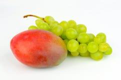 Mango and green grapes. Royalty Free Stock Image