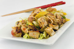 Mango and Grilled Chicken Salad. With chopsticks Stock Image