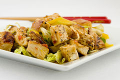 Mango and Grilled Chicken Salad. With chopsticks Stock Images