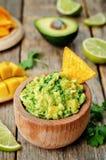 Mango guacamole with corn chips stock photo