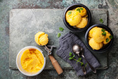 Mango ice cream sorbet with mint leaves Royalty Free Stock Images