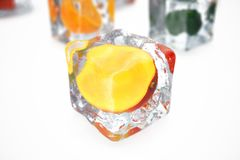 Mango in ice cube isolated on white with depth of field effects. Ice cubes with fresh berries. Berries fruits frozen in. Ice cubes. 3D rendering Royalty Free Stock Photo