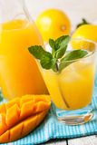Mango ice tea with mint in a glass Stock Images