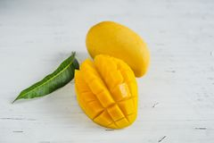Free Mango In The Basket On White Wood Background Royalty Free Stock Images - 150808549