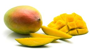 Fresh mango isolated. Mango isolated on white background one whole three slices and sliced hedgehog half Royalty Free Stock Photos