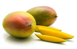 Fresh mango isolated. Mango isolated on white background two whole and three slices Stock Photo