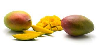 Fresh mango isolated. Mango isolated on white background two whole three slices and sliced hedgehog half Stock Images