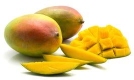 Fresh mango isolated. Mango isolated on white background two whole three slices and sliced hedgehog half Stock Photos