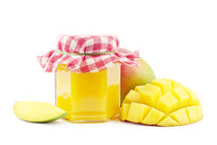 Mango jam. With fresh mangoes on white Stock Photography