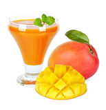 Mango juice. In a glass over white background Royalty Free Stock Images