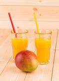 Mango and juice. Close up. Royalty Free Stock Photos