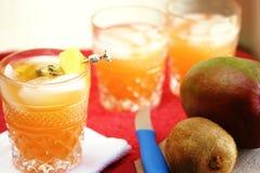 Mango Juice Cocktails. Mango Juice and Vodka Cocktails with kiwi and mango Royalty Free Stock Photos