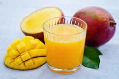 Mango juice and fresh mango Stock Images
