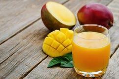 Mango juice and fresh mango Royalty Free Stock Image