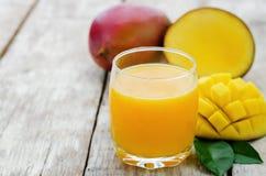 Mango juice and fresh mango Royalty Free Stock Photo