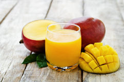 Mango juice and fresh mango Royalty Free Stock Photo