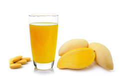 Mango juice in a glass and vitamin c tablet on white background Stock Image