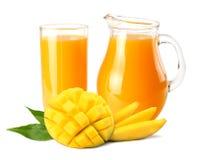 Mango juice with mango slice isolated on white background. jug of mango juice. royalty free stock photos