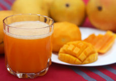 Mango juice with sliced fruit Royalty Free Stock Photography