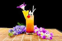 Mango juice soda and fruit on glass near flower isolation black Stock Images