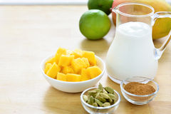Mango lassi smoothie ingredients. Stock Photos