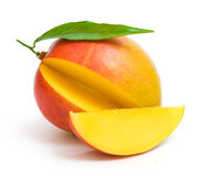 Mango with a leaf and a slice Royalty Free Stock Photo
